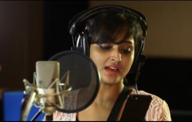 Actress Remya Nambeesan Singing Song in Koothan Stills